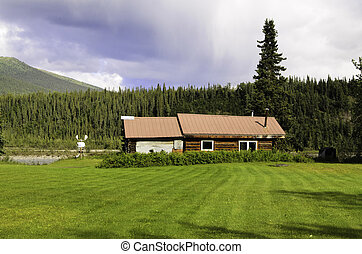Wiseman village Alaska - A view of a log home in Wiseman...