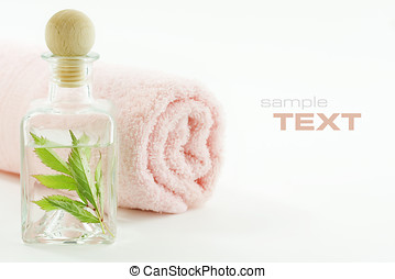 Jar with fresh leaves and towel (SPA concept)