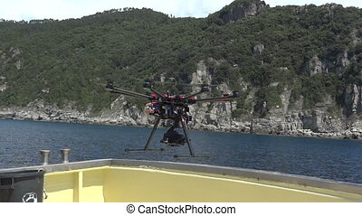 Drone taking off from a boat - Drone equipped with video...