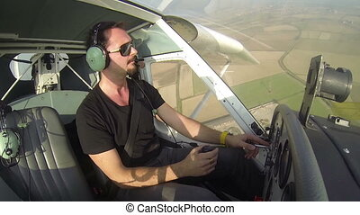 Pilot flying on small airplane - Pilot flying alone on small...