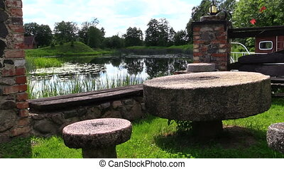 table bench river - Table and benches made of stone...