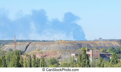 Fire at the Airport Smoke rises above the horizon Donetsk,...