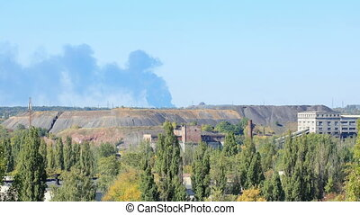 Fire at the Airport. Smoke rises above the horizon. Donetsk,...
