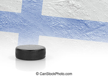 Hockey puck and the Finnish flag - Hockey puck and the image...
