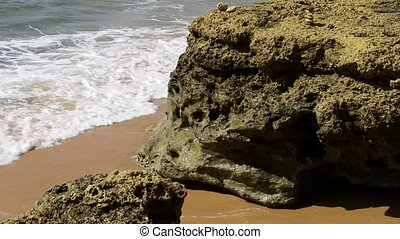 Maria Luisa beach in Albufeira, Portugal. Detail of orange...