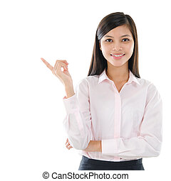 Asian business woman pointing on copy space