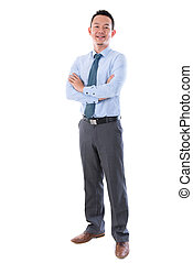 Middle aged Asian business man smiling, full length standing...