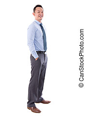 Asian business man smiling, full length standing isolated...
