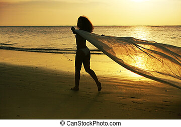 beautiful woman - The beautiful woman on a coast on a sunset