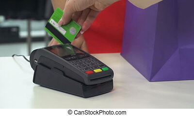 POS Payment - Anonymous cashier checking out unidentified...