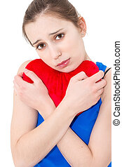 lonely sad woman holding red valentine heart - young lonely...