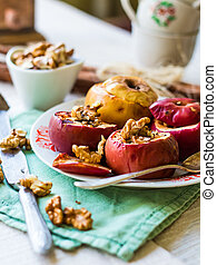 sweet baked apples with walnuts and honey, dessert...