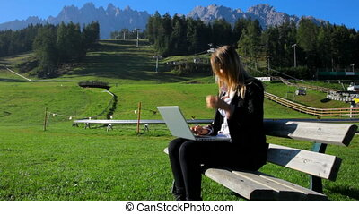 Business woman working with pc - Woman enjoying reading on...