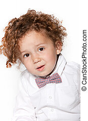 Cute Curly Baby Boy in White Long Sleeves with Bow Tie....