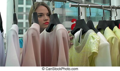 Rich and Trendy - Close up of pretty young woman shopping in...