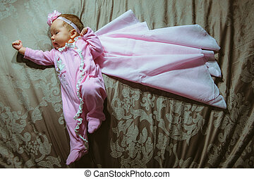 Image of cute little girl in pink suit and cloak indoor...