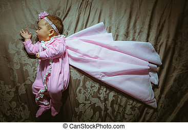 Image of cute little girl in pink suit and cloak indoor....