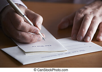 Close Up Of Man Completing Last Will And Testament