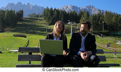 Enjoying business in the mountain - Business man and woman...