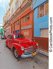 Vintage red car on the street of old city, Havana, Cuba