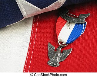Eagle Scout Award on Flag - Close up of an Eagle Scout Award...