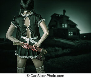 Dirty woman stands back holding a bloody ax - Halloween...