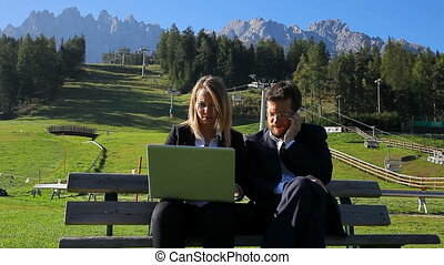 Business people in the mountain - Two business people...