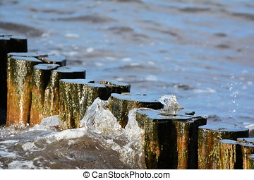on the beach - Breakwater on the beach of the Baltic Sea in...