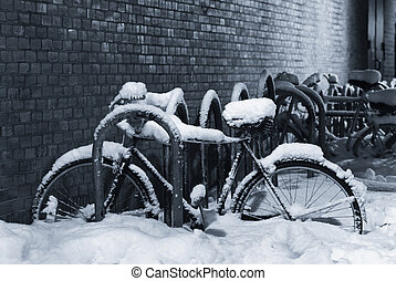 Snow-covered bicycle - Night shot of a bike under a thick...