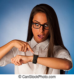 stressed woman staring into watch gesturing being late