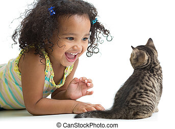 Happy kid girl lying on floor and playing with kitten isolated