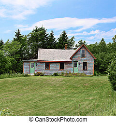 Old home with landscaped front yard in Summer - home with...