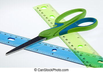 Measure twice, cut once - Scissors resting on two rulers,...