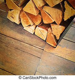 Firewood on old rustic floor - Pile of firewood on old...