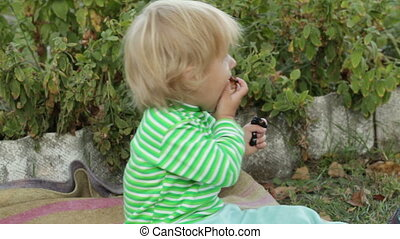 Girl child eats meat - Little girl eating a piece of shish...