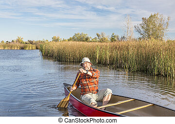 canoeing on a lake