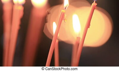 Lights Candles - In Church, light candle and put next to...