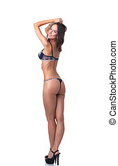 Sexy slim lingerie model posing back to camera, isolated on...