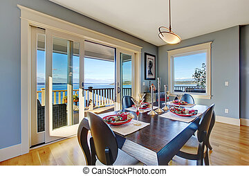 Light blue dining area with sliding glass door to walkout...