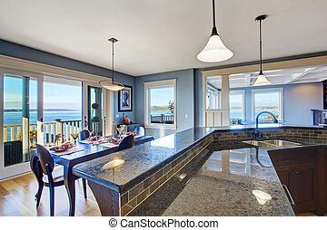 Luxury kitchen. Cabinet with granite top and tile trim