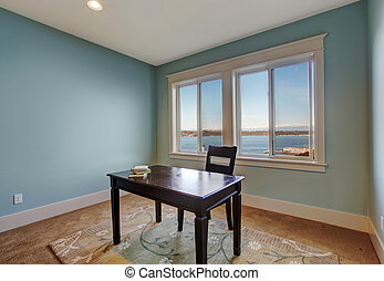 Simple office room in light blue color