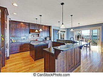Luxury kitchen with dark brown storage combination