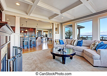 Luxury house with open floor plan. Coffered ceiling, carpet...