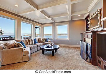 Warm living room interior in luxury house with Puget Sound...