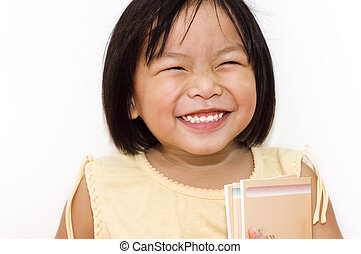 Happy going to school. - A cute Asian girl happy with her...