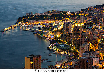 Monte Carlo in View of Monaco at night on the Cote d'Azur -...
