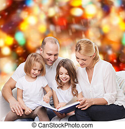 happy family with book at home - family, childhood, holidays...