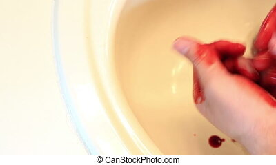 Cleaning Bloody Hands in Sink