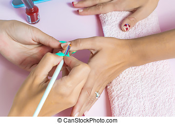 Woman receiving a manicure