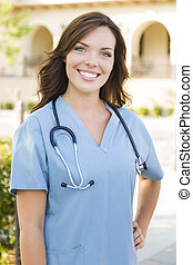 Proud Young Adult Woman Doctor or Nurse Portrait Outside